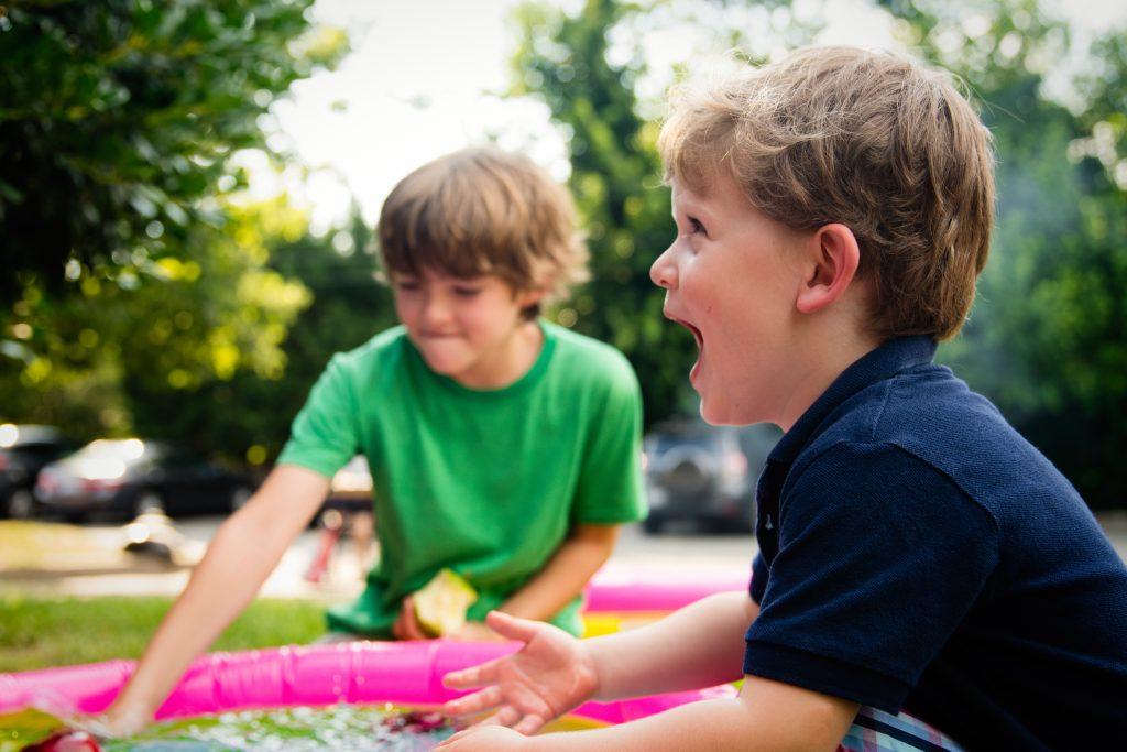 Boys bobbing for apples