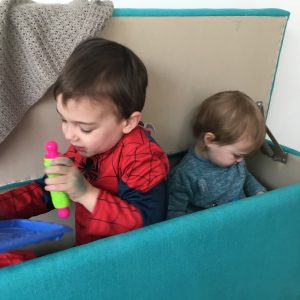 children in a box pretending to be an aeroplane