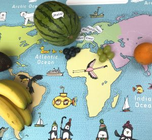 A map of the world with fruit showing where it comes from
